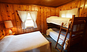 Bedroom with double bed and two bunk beds