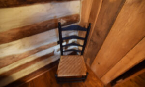 Corner of Logs with Clore Chair