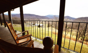 Shared Porches with Rockers and Exterior Lodge Room Entrances - for Shenandoah National Park View Hotel at Graves Mountain